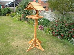 The Whey Bird Table – wooden garden bird table sold by Berkshire Log Stores in the UK